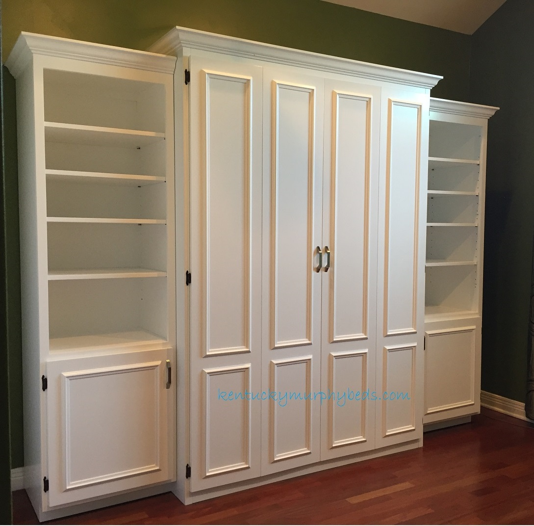 White painted MDF full size Murphy bed, flat panel surface trimmed doors, two bookcases