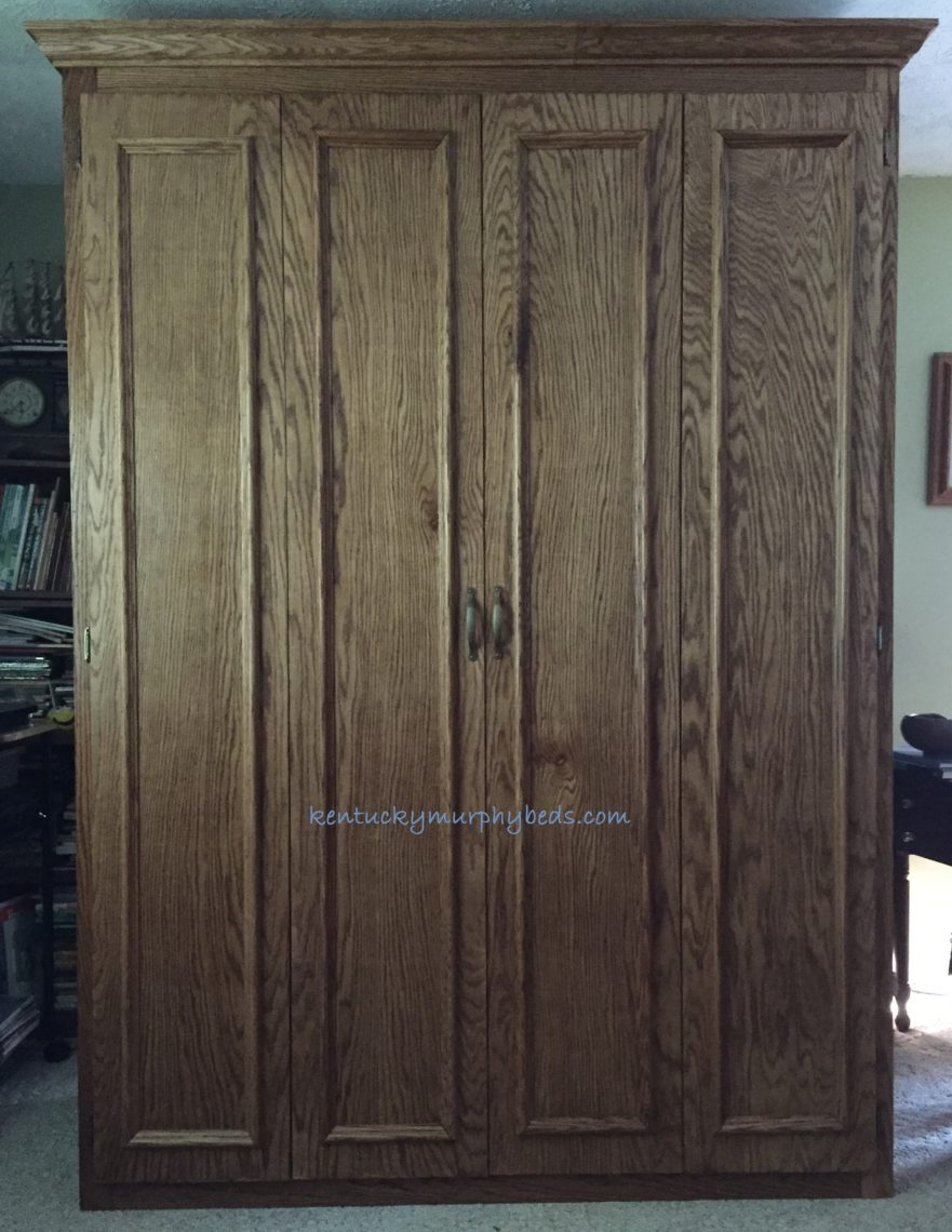 Oak full size Murphy bed with honey oak finish