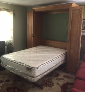 oak Murphy bed full size, bed down position