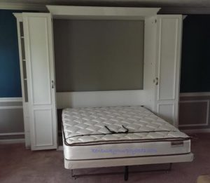 White painted maple queen Murphy bed with bifold doors and two accessory cabinets - bed down 2017 Home Show bed